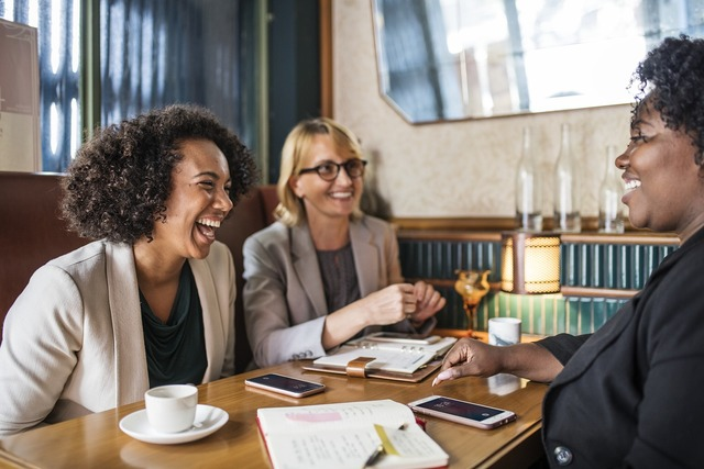 three ladies networking at a restaurant to find clients