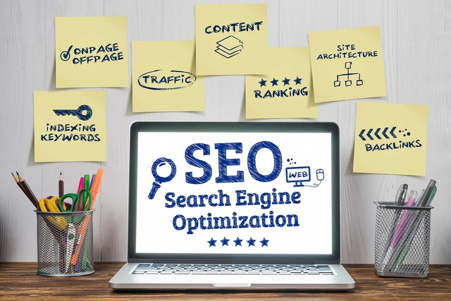 """Laptop with the words""""search engine optimization"""" to find clients"""